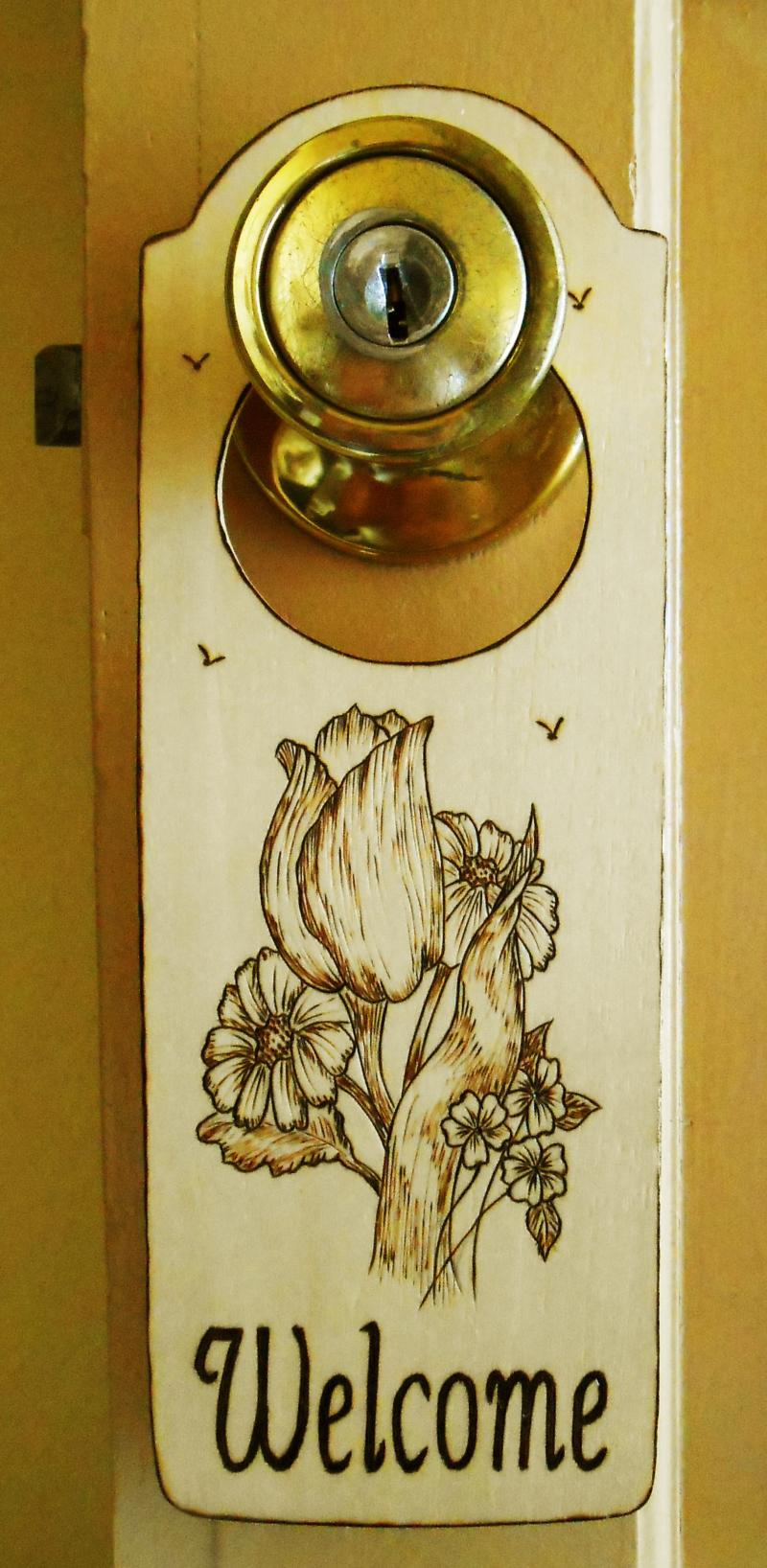 "/31-14, ""FLORAL BOUQUET"", shown on door knob."
