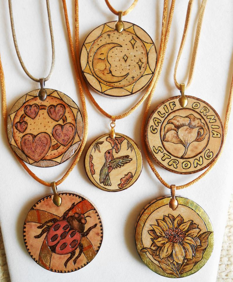 "Display of 2"" wood pendants with 1-1/2"" in the center.  See Pendant Gallery's."