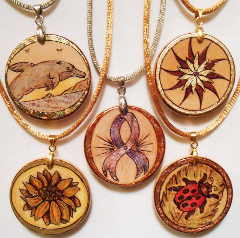 "Display of1-1/2"" Pendants. Look at Thumbnails on left for details on. each"