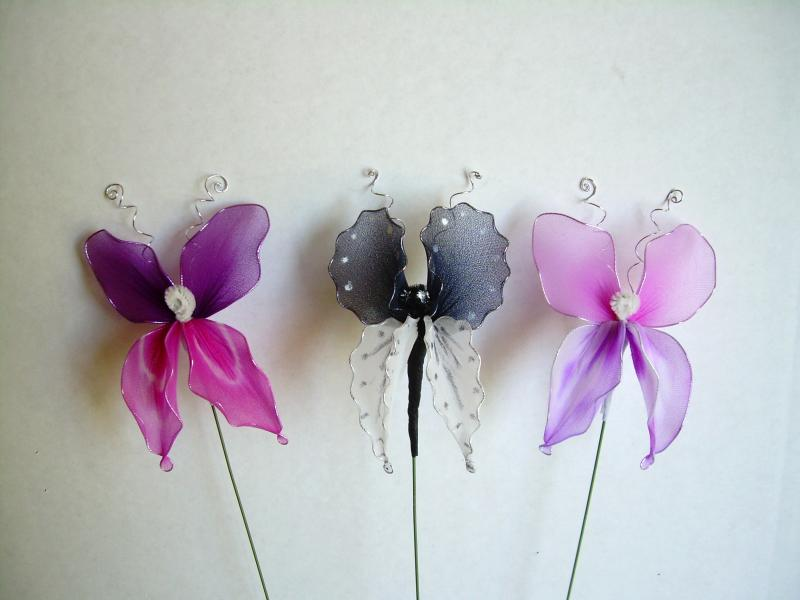 "Nylon Butterflies, Swallow tails, just a bit over 4"", on long wire, $5.00 each."